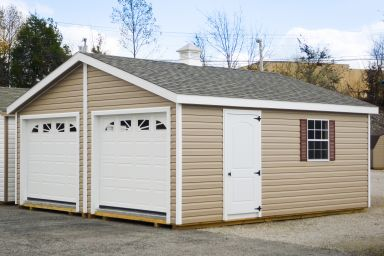 A prefab two-car garage in Kentucky with vinyl siding