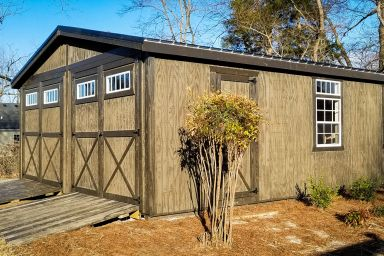A prefab two-car garage in Tennessee with wooden siding