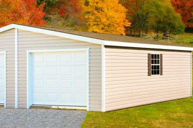 A two-car custom garage in Tennessee with vinyl siding