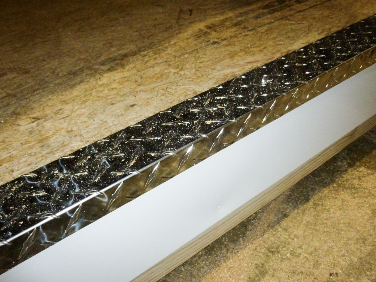 Diamond plate door threshold on a prefab shed in Kentucky